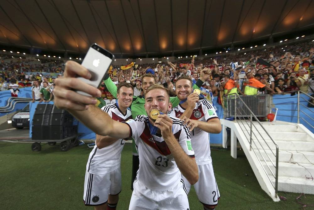 German footballers make a selfie with their gold medal