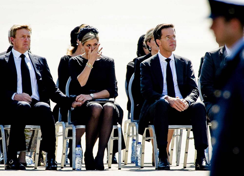King Willem-Alexander, Queen Maxima and Dutch Prime Minister Mark Rutte at the airbase in Eindhoven