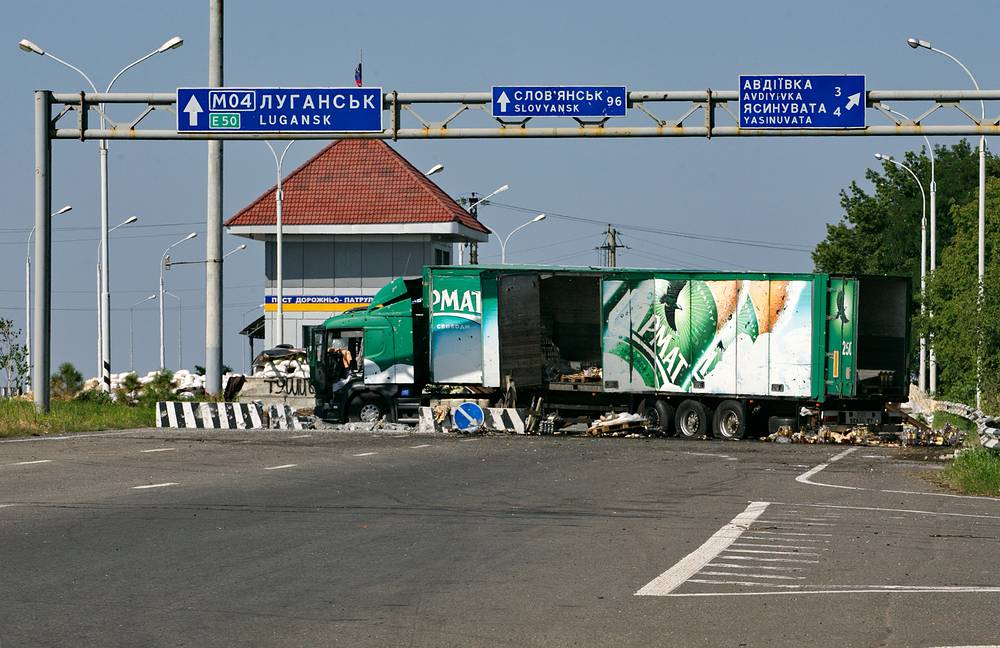 A truck blocks the way at a checkpoint in the town of Yasinovataya, Donetsk Region