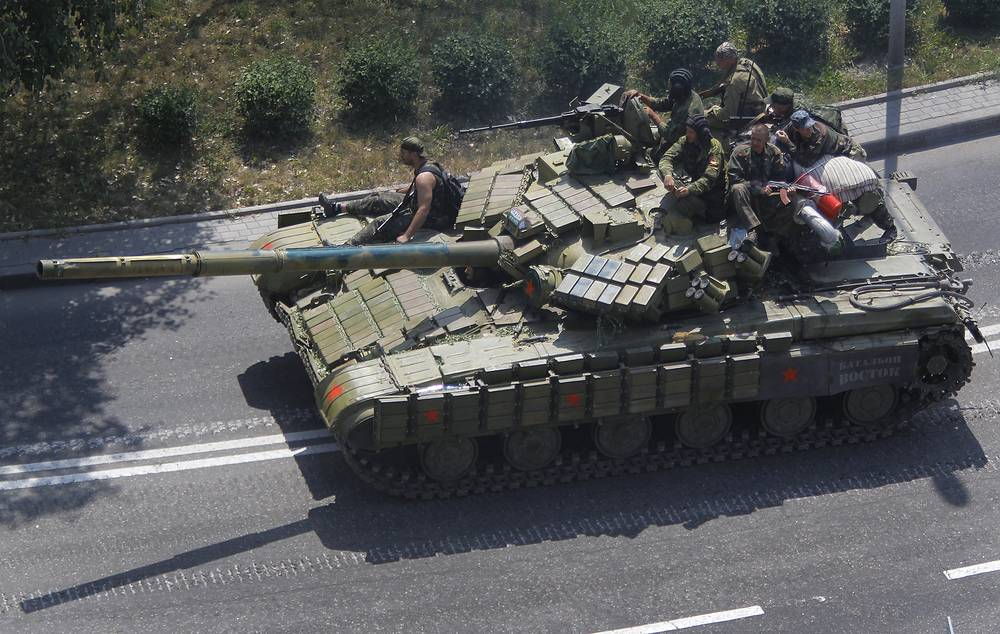 Donetsk militia fighters seen on a tank in Donetsk