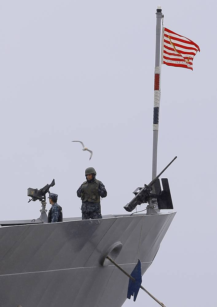 A marine abord the US Ticonderoga class guided missile cruiser Vella Gulf