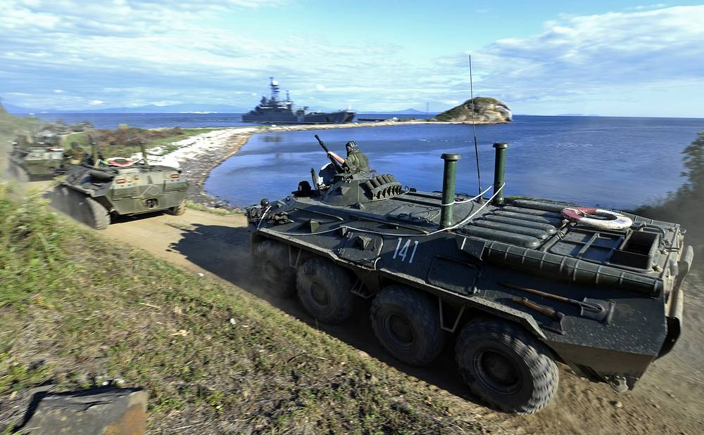 Armored vehicles of Russia's Marine Forces get ready to board an amphibious ship
