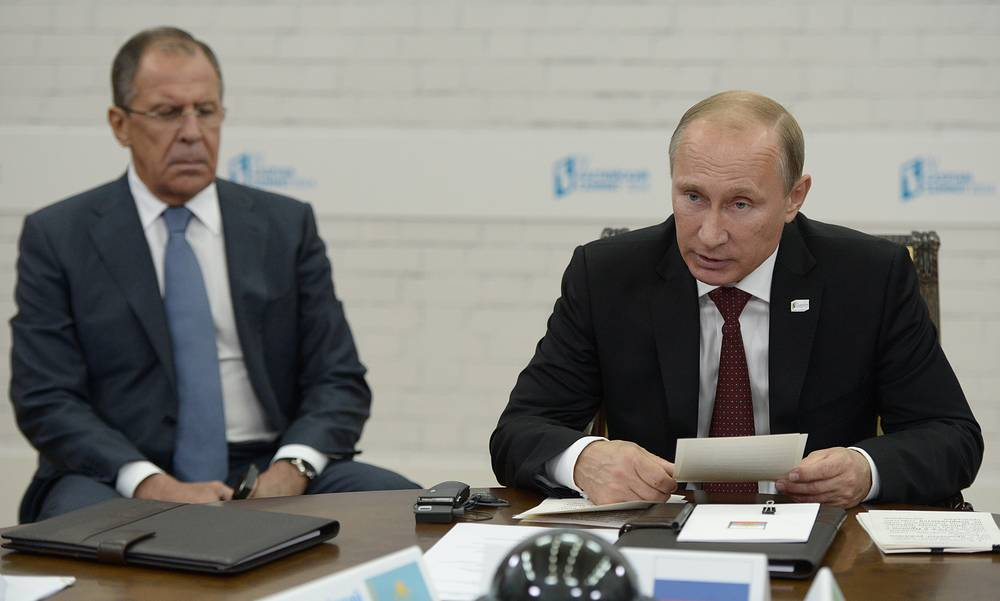 Vladimir Putin and Russia's Foreign Minister Sergey Lavrov at the summit