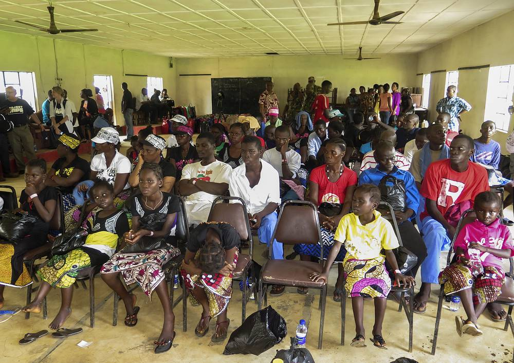 Photo: Sierra Leone Ebola survivors wait with relatives and friends during a discharge ceremony from the Hastings treatment centre outside Freetown, Sierra Leone, 06 October 2014