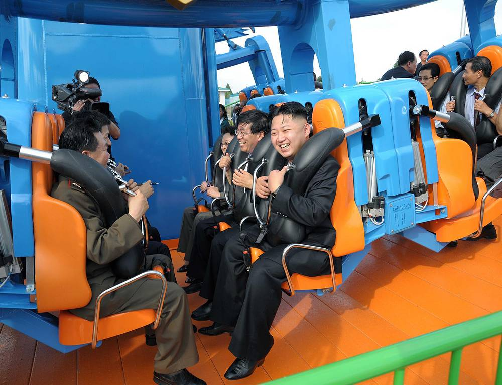 Photo: Kim Jong Un reacts on a ride as he attends the completion ceremony of the Rungna People's Pleasure Ground in Pyongyang, photo released July 26, 2012