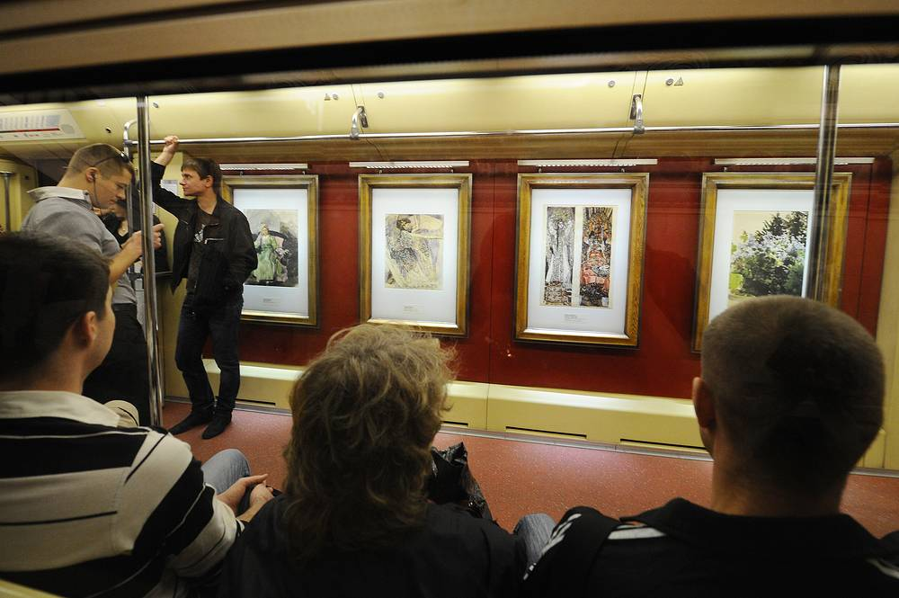 The Moscow Metro is undergoing a major expansion, that will see its metro stations increase by almost 40 percent between now and 2020. Passengers in a car of the Aquarelle Train, displaying reproductions of paintings from the State Tretyakov Gallery collections, 2012