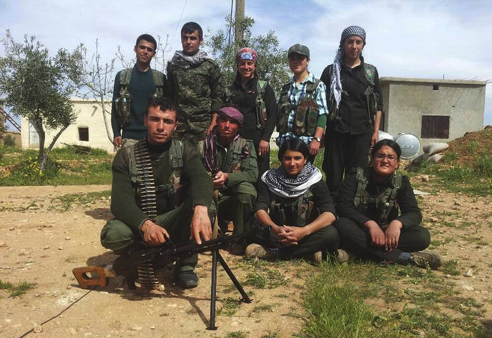 Kobani, also known as Ayn Arab, and its surrounding areas, has been under assault by extremists of the IS group since mid-September and is being defended by Kurdish fighters. Photo: Syrian Kurdish fighters on the outskirts of Kobani, Syria