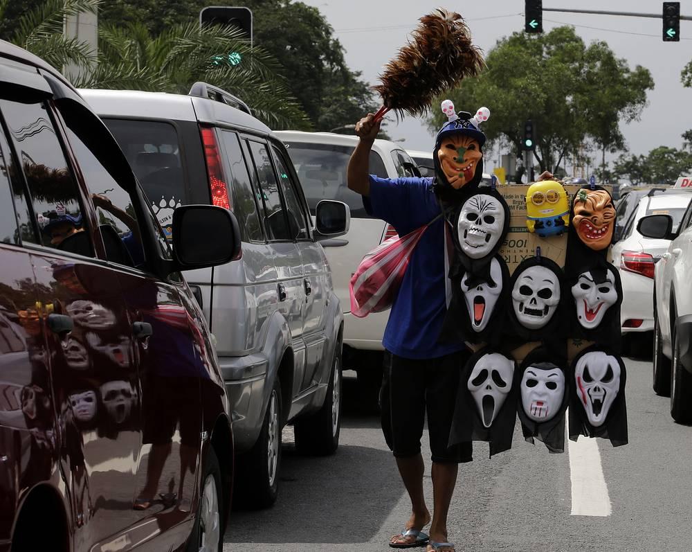 Photo: Vendor sells masks in Manila, Philippines, October 30, 2014