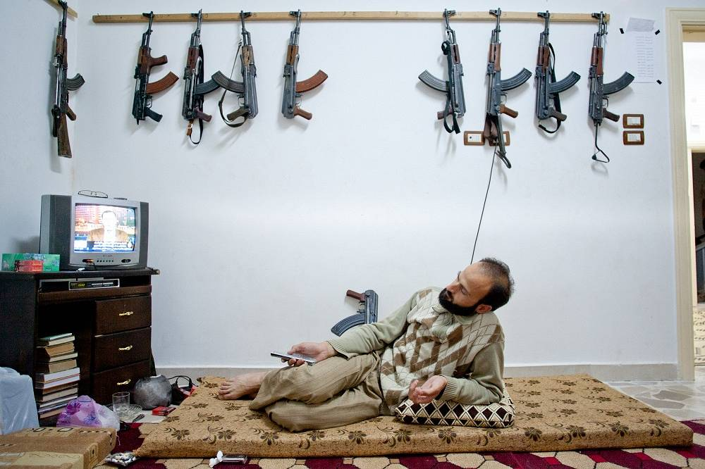 Photo: Kalashnikov assault rifles hang on the wall as Free Syrian Army (FSA) member in northern Syria