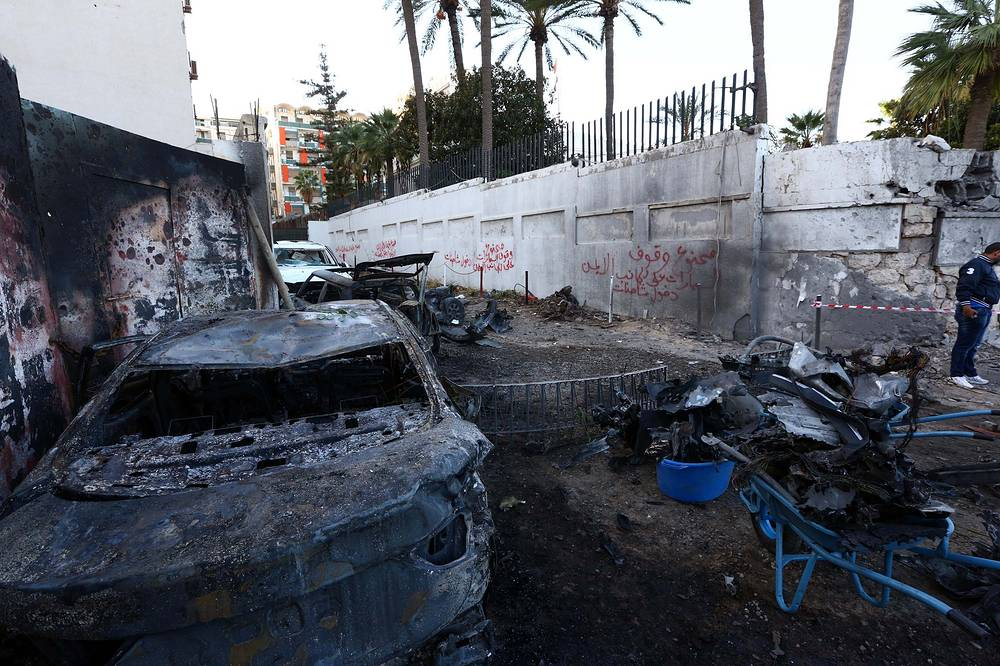 Photo: Destroyed cars at the scene of a car bomb explosion near the Egyptian embassy in Tripoli, Libya