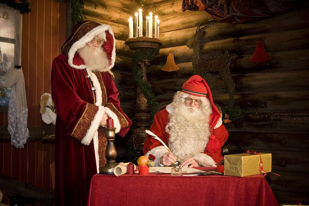 Photo: Joulupukki of Finland and his Hungarian counterpart sign a friendship treaty in the Santa Claus House