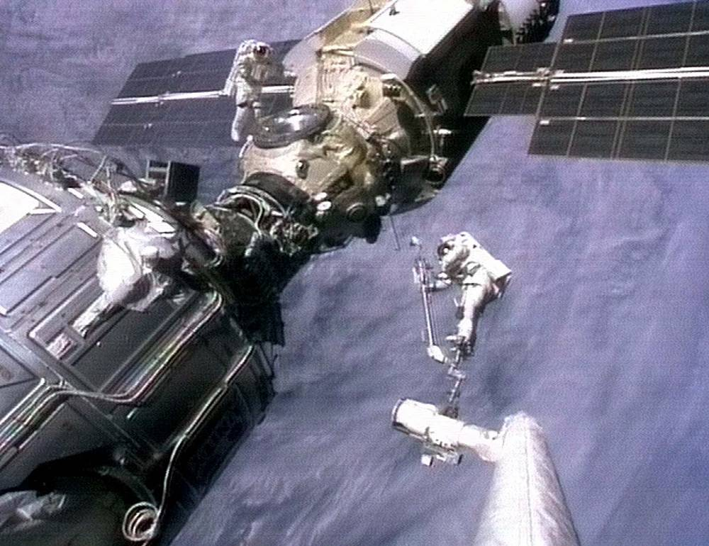 First component of ISS, module Zarya was launched in 1998. Photo: Astronauts Jerry Ross and Jim Newman preparing to unfurl an antenna on the Russian-made module Zarya, 1998