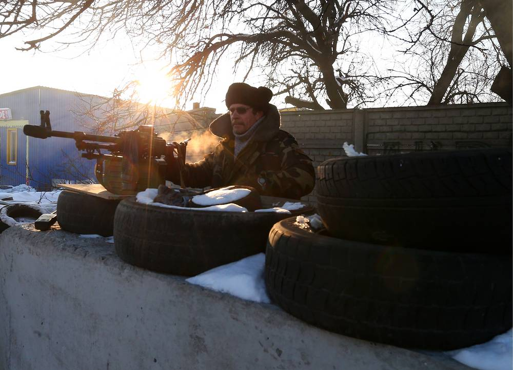 Photo: Local militia man at a checkpoint in Donetsk