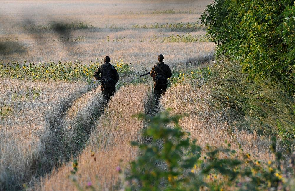 Soldiers patrol the territory of a tent camp for Ukrainian servicemen who crossed into Russia seeking refuge