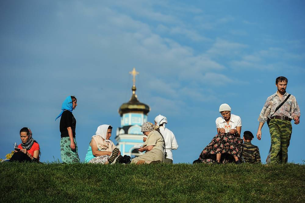 Believers wait for the start of a religious procession near a church in Yekaterinburg