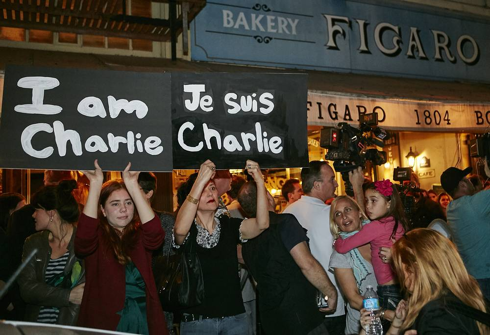 "Members of the French-American community of Los Angeles hold signs reading ""I'm Charlie,"" outside of the French restaurant in Los Angeles, USA"