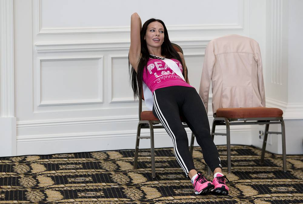 Miss Universe contestant Yulia Alipova of Russia takes a break after participating in a Zumba Class for the contestants