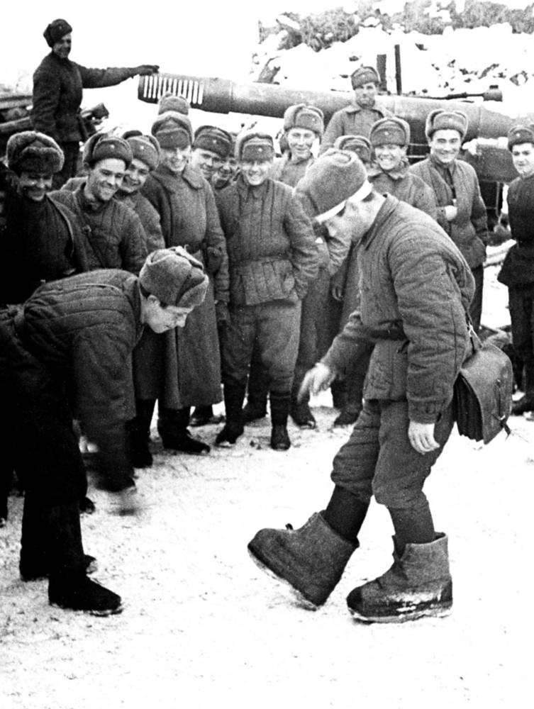 The Red Army soldiers demonstrating German ersatz boots at one of the liberated districts of Stalingrad