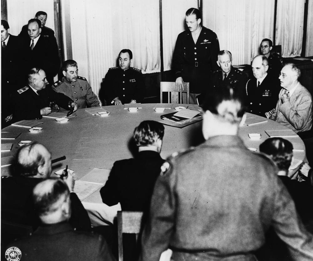 Around a circular table at Yalta Palace, Crimean Peninsula, Russia, February 4, 1945 Soviet Marshal Joseph Stalin, US President Franklin D. Roosevelt and British Prime Minister Winston Churchill and their staffs at the opening of eight-day conference on plans to crush Nazism