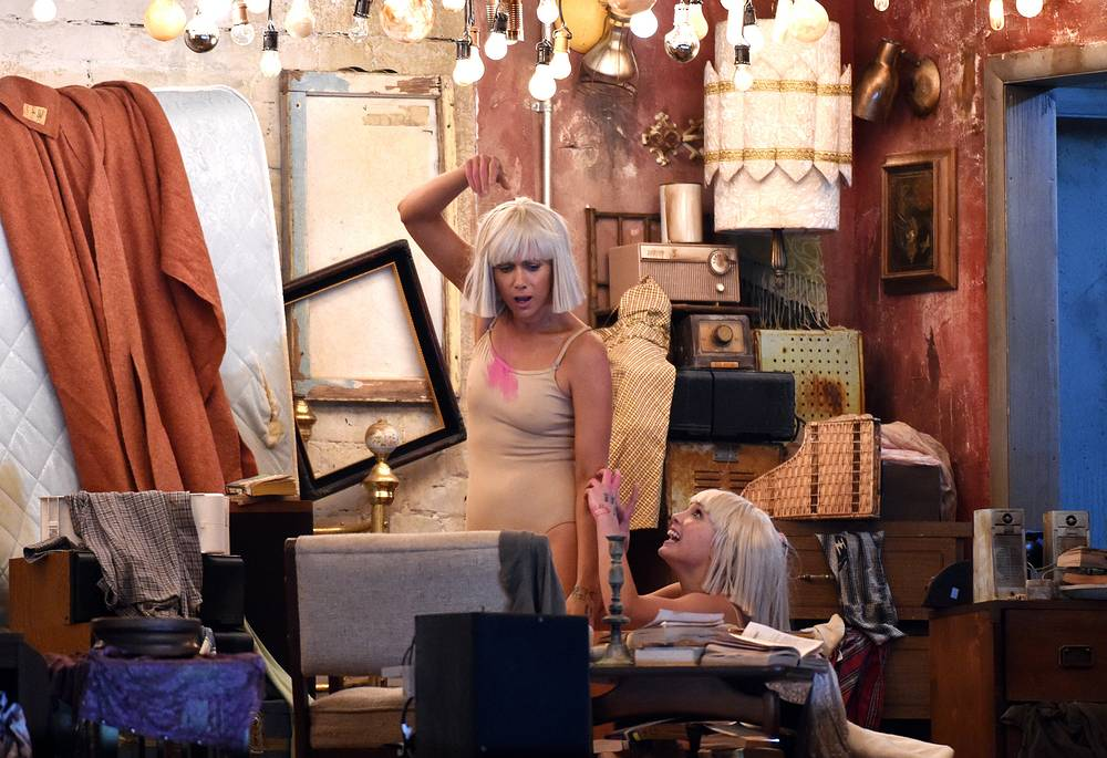 """Kristen Wiig and Maddie Ziegler performing as Sia sings """"Chandelier"""" at the 57th Grammy Awards"""