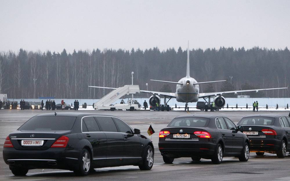 Cars carrying members of the German delegation including Chancellor Angela Merkel driving to the Palace of Independence in Minsk