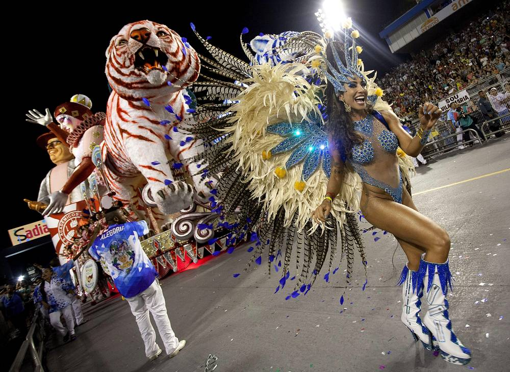 TV hostess Jaque Khury, member of samba school Imperio de Casa Verde, takes part in a carnival parade at Anhembi Sambodrome during second day of Brazilian carnival in Sao Paulo
