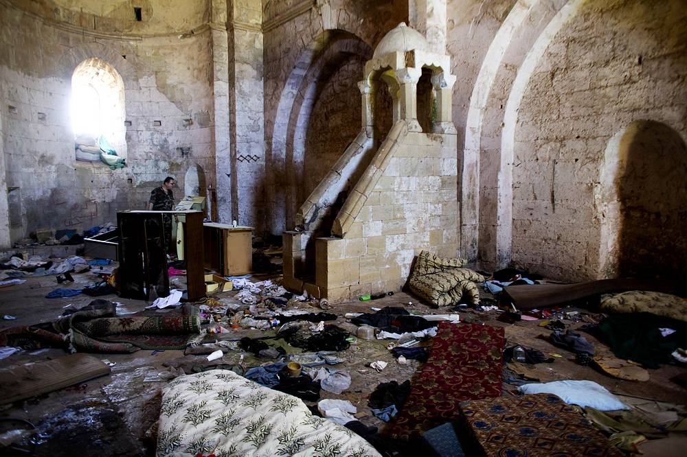 Belongings of Syrian rebels inside a chapel at Crac des Chevaliers, the world's best preserved medieval Crusader castle, in Syria