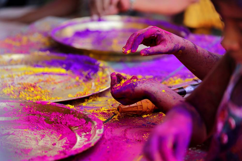 Children applying color on each other as they celebrate the Holi festival in Calcutta, India