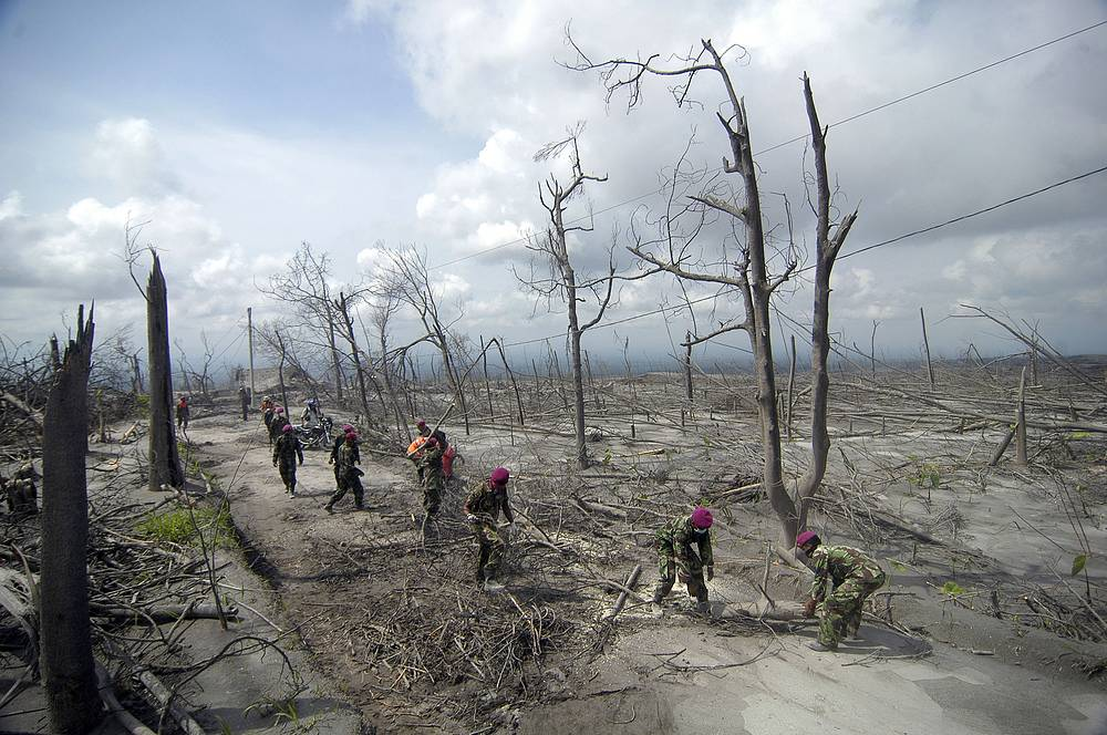 347 people were killed during the eruptions. Photo: Indonesian soldiers cleaning the damaged area after Mount Merapi eruptions