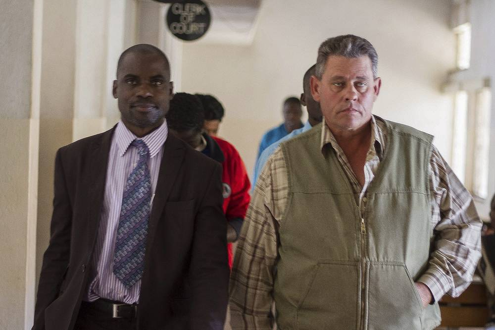 Theo Bronkhorst, who assisted Palmer, accompanied by his lawyer at the Hwange Magistrates courts, Zimbabwe
