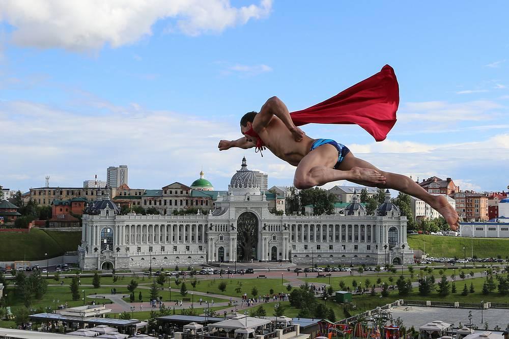 Michal Navratil of the Czech Republic performs after the men's 27 meter high dive final