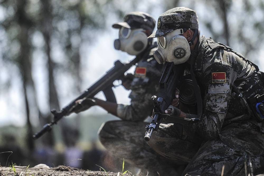 Chinese soldiers wearing gas masks seen during an assault course in the Scout Trail competition