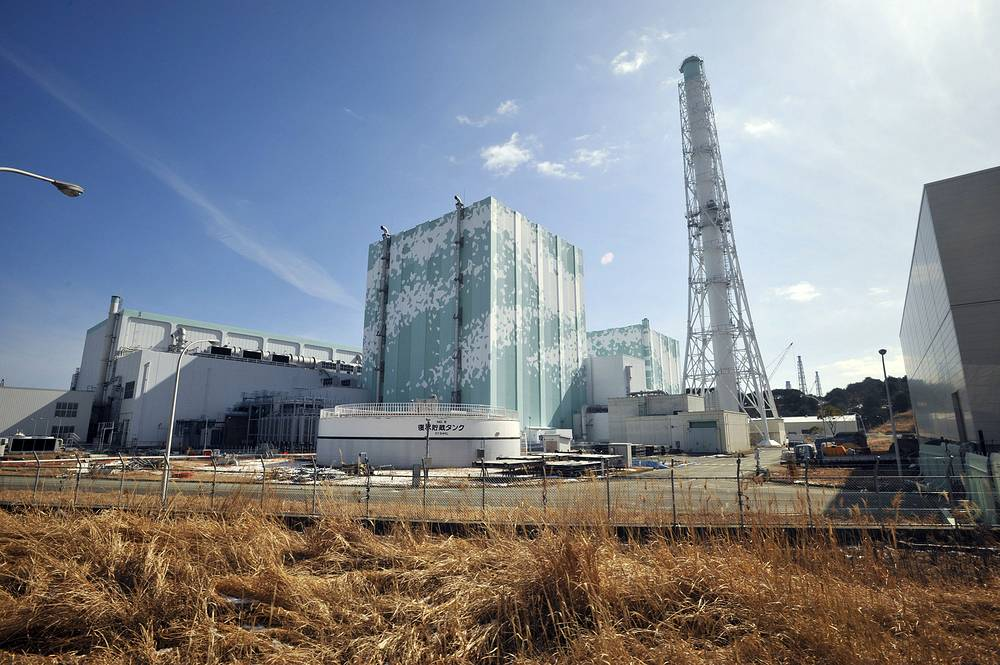 The government later introduced stricter safety standards in case of accidents and disasters. Photo: Reactor buildings at Tokyo Electric Power Co.'s tsunami-crippled Fukushima Dai-ichi nuclear power plant in Okuma