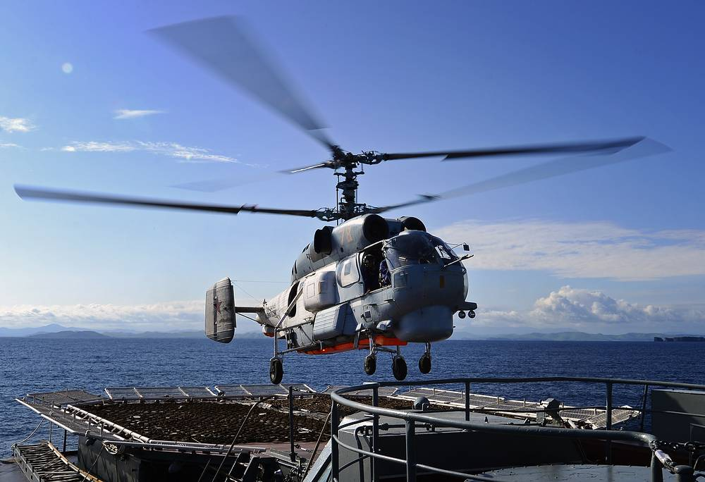 A Ka-27PS helicopter takes off from the Russian cruiser Varyag