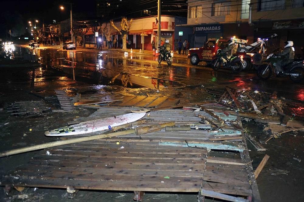 Police patroling a debris strewn street in Valparaiso, Chile