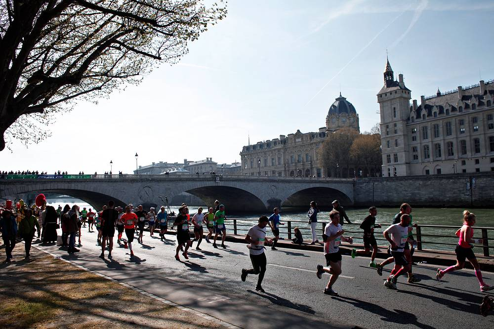Runners making their way along the Seine river during the Paris Marathon, 2015