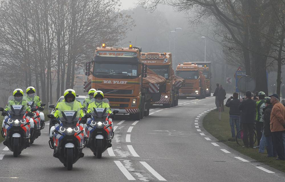 Trucks carrying parts of the wreckage of downed Malaysia Airlines flight MH17, Netherlands, December 9, 2014