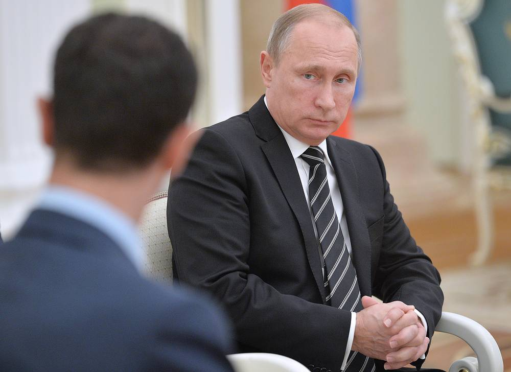 Russian President Vladimir Putin at a meeting with his Syrian counterpart Bashar al-Assad