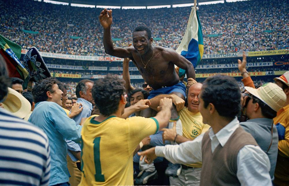 Brazil's Pele, centre is hoisted on the shoulders of his teammates after Brazil won the World Cup soccer final against Italy, 4-1, in Mexico City's Estadio Azteca, Mexico