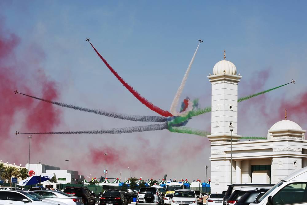 UAE Air Force aerobatic team Al Fursan in flight at the 2015 Dubai Airshow