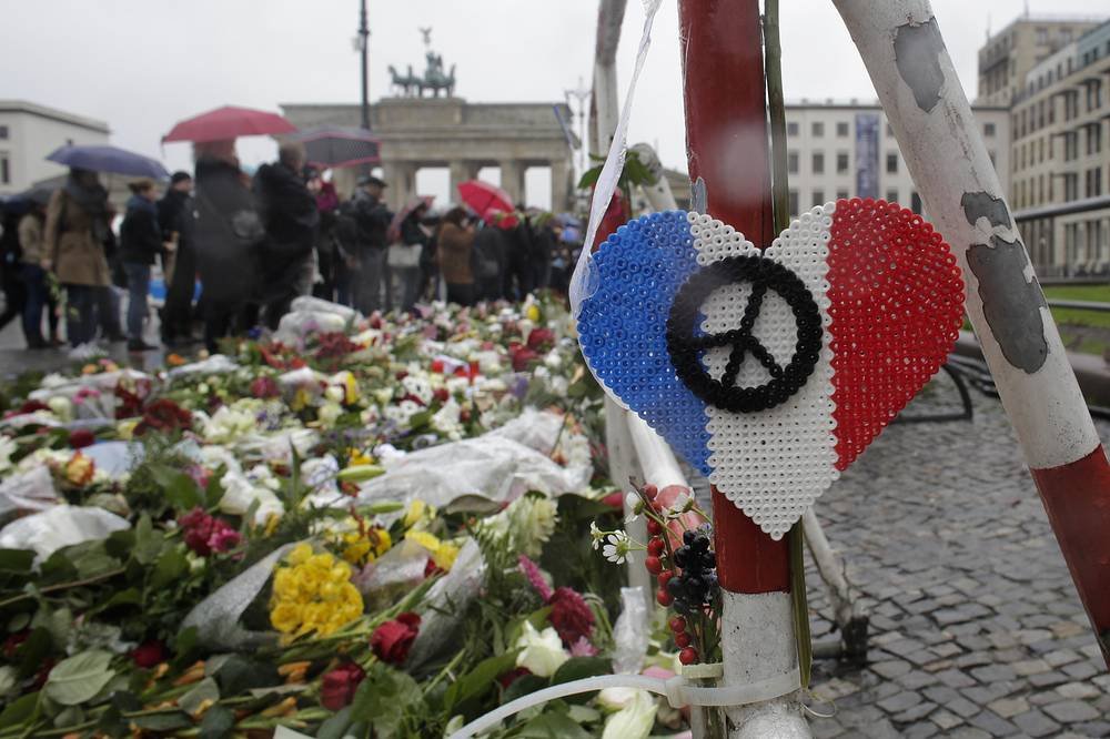 Flowers and candles in front of the French embassy near the Brandenburg Gate in Berlin, Germany