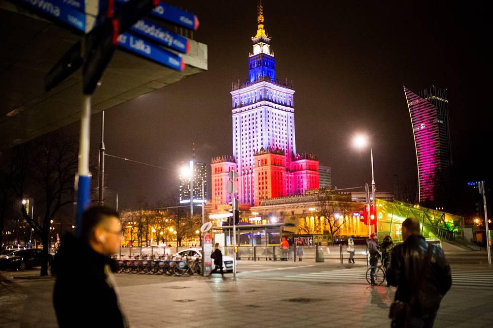 Palace of Culture and Science lit up in the colours of the French national flag in Warsaw, Poland