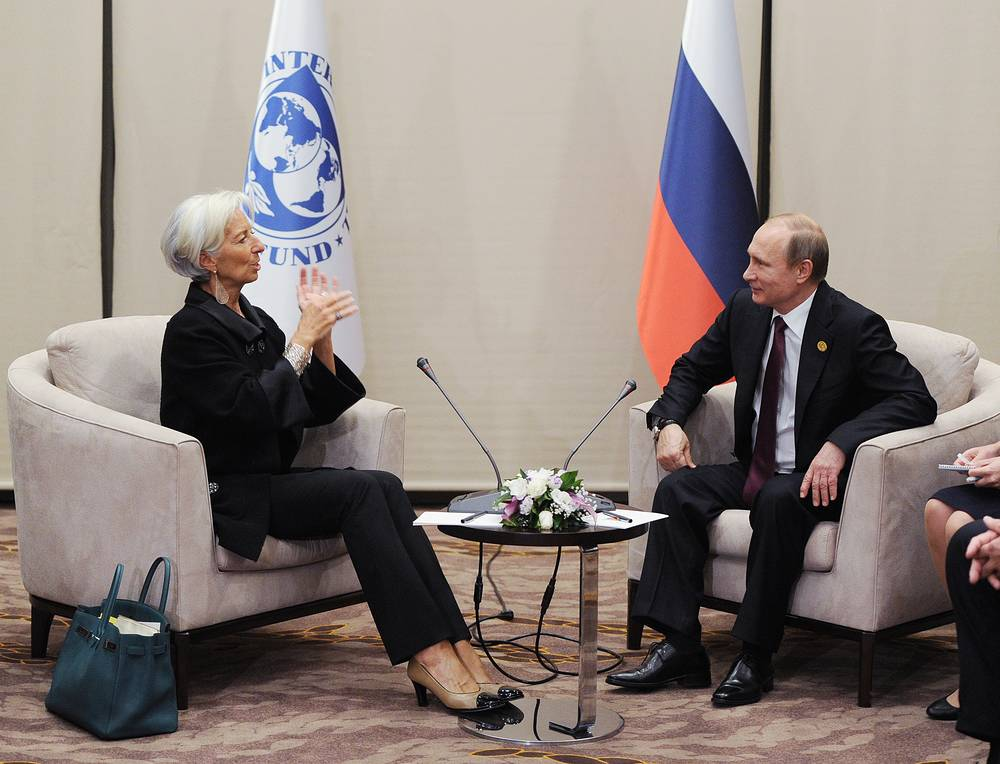 Russian President Vladimir Putin speaking with the Managing Director of the International Monetary Fund Christine Lagarde