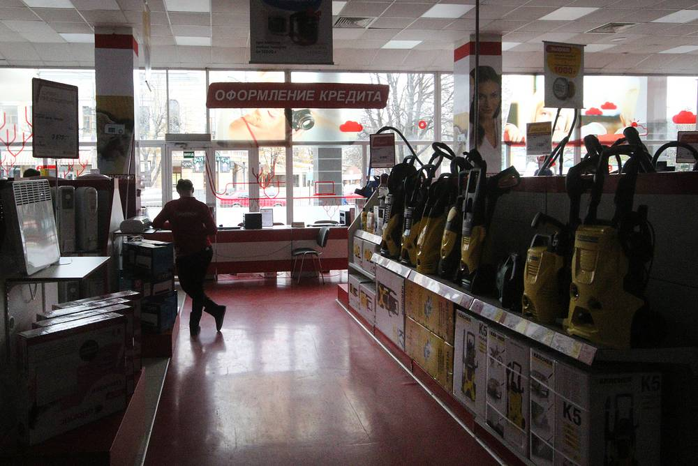 Local residents in a household appliances store during a blackout in the village of Stroganovka
