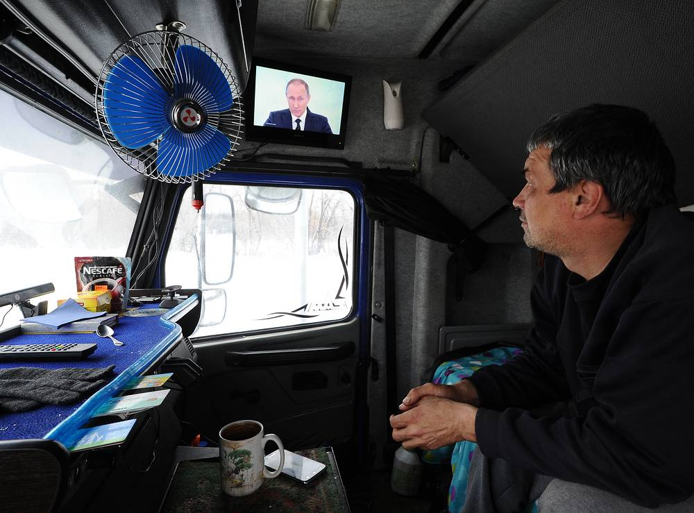 A truck driver watching the address