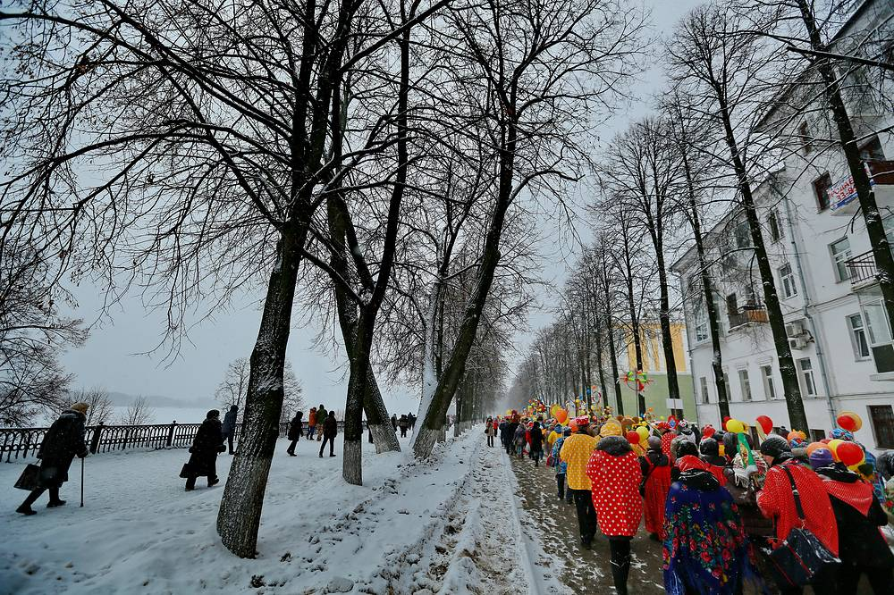 People celebrating Maslenitsa, Russian folk holiday, marking the end of winter and the arrival of spring, February 15, 2015