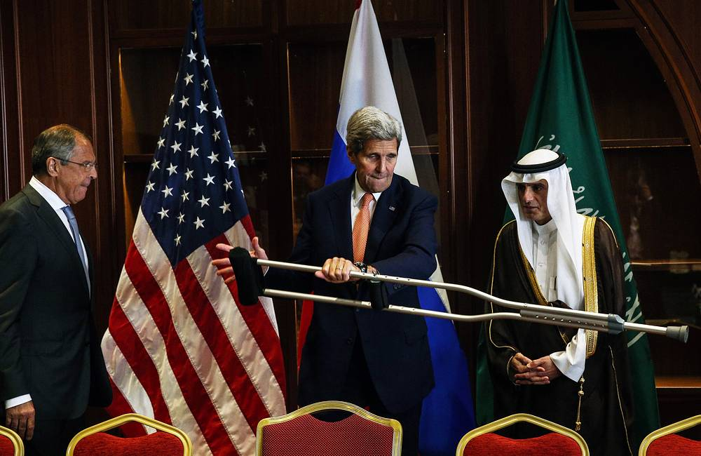 Russia's Foreign Minister Sergei Lavrov, US Secretary of State John Kerry, and Saudi Arabia's Foreign Minister Adel al-Jubeir seen during a trilateral meeting in Doha, Qatar, August 3, 2015