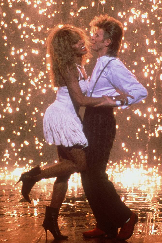 Rock stars Tina Turner and David Bowie dancing together during a commercial, 1987, for Pepsi-Cola USA