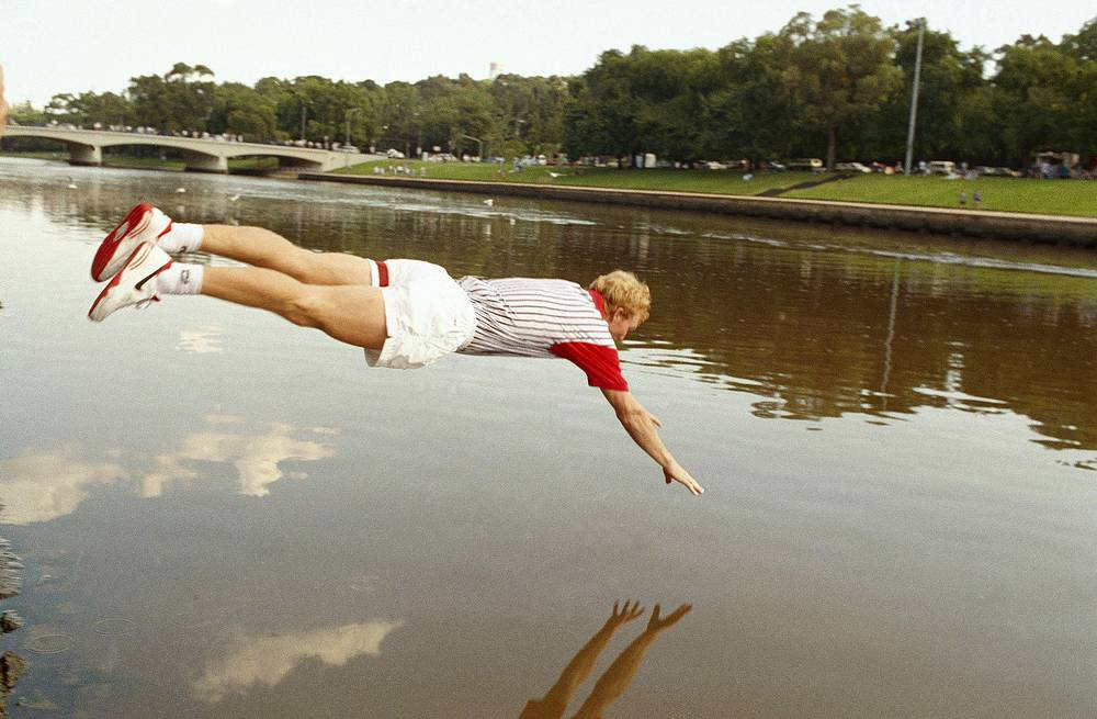 Jim Courier of USA diving in the Yarra River, after defeating Sweden's Stefan Edberg in the men's final at the Australian Open Tennis Championship in 1993