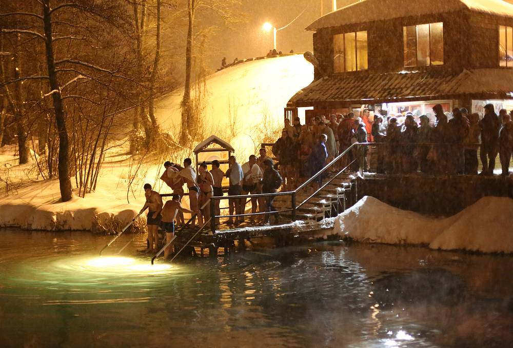 People plunging into the waters of non-freezing springs in the village of Shopino, Belgorod region